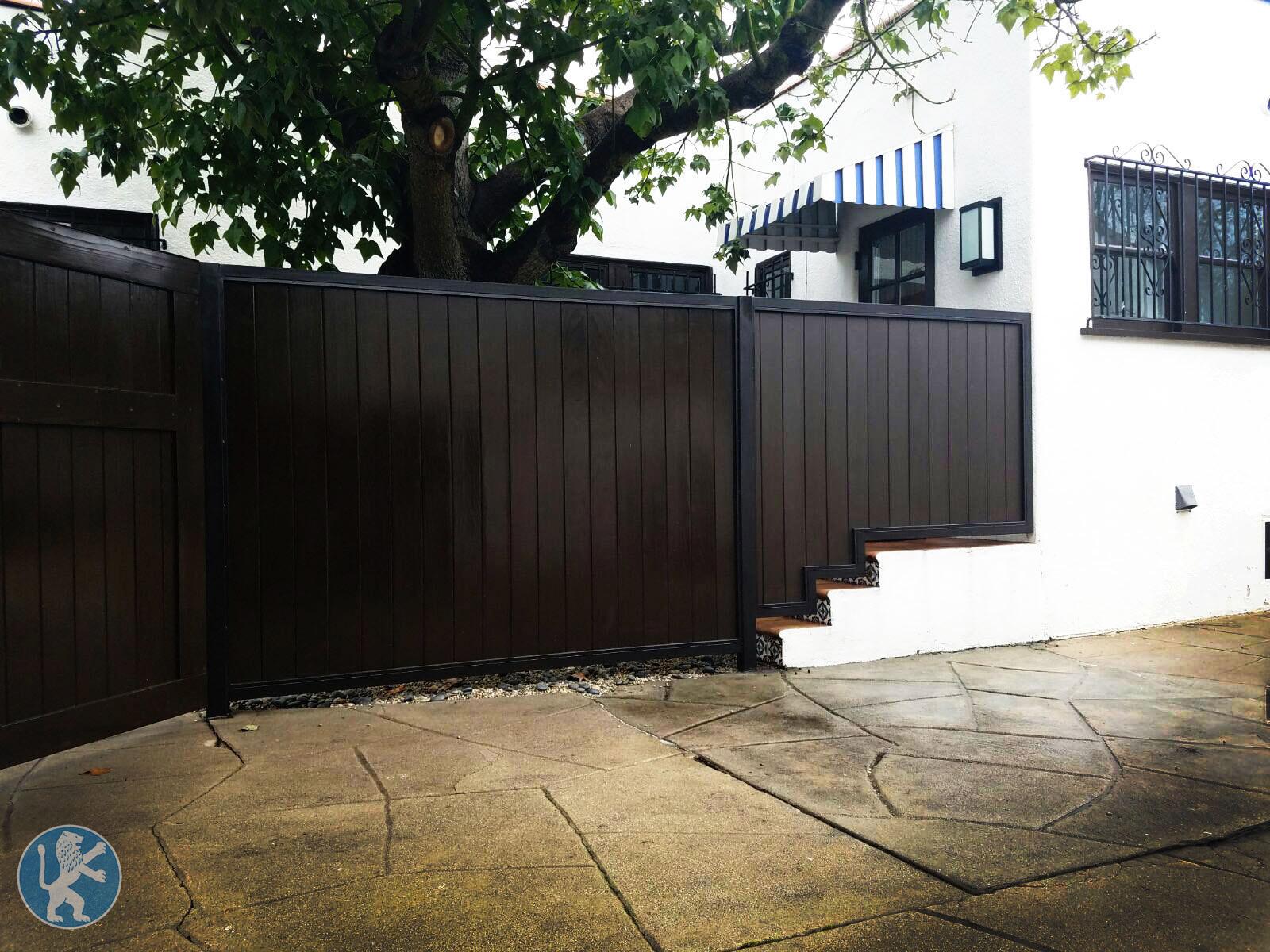 Prfct fencing 11 perfect garage doors gates inc for Garage fence