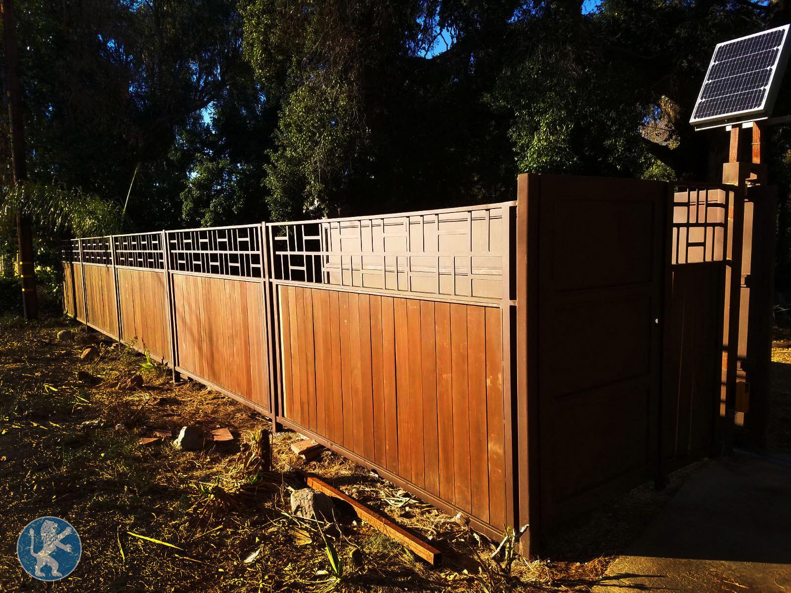 Prfct fencing 13 perfect garage doors gates inc for Garage fence