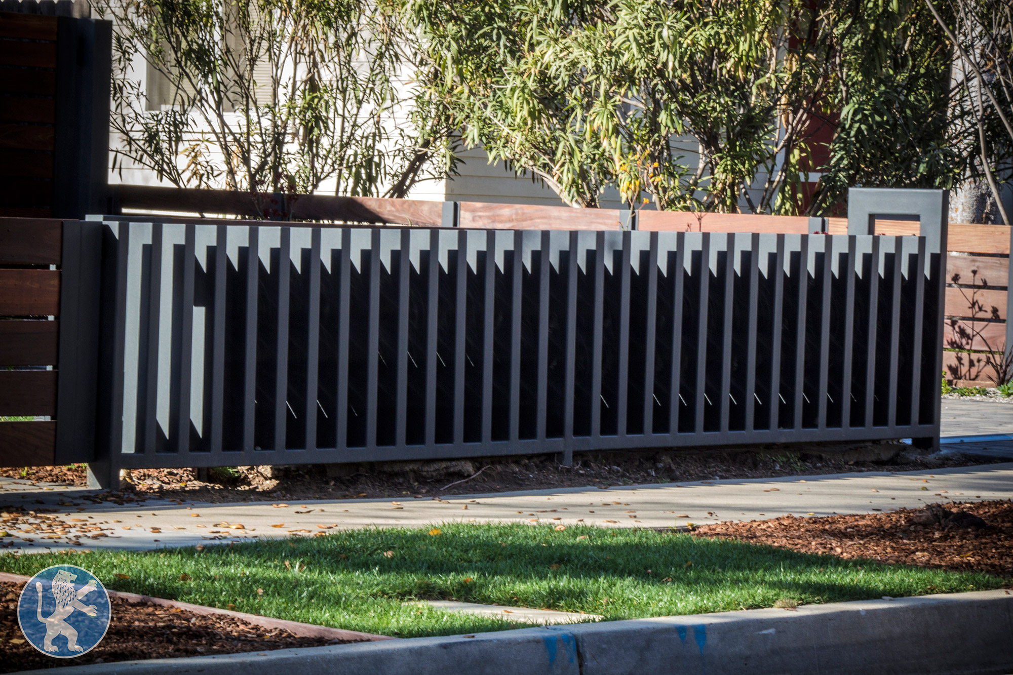 Fencing perfect garage doors gates inc for Garage fence